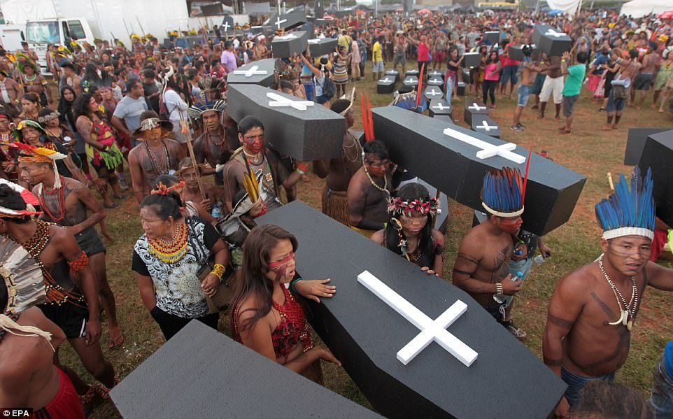 Brazilian indigenous people carry dozens of coffins replicas in a protest at Explanada dos Ministerios in Brasilia. Close to 2,000 indigenous people of several tribes of the country gathered in Brasilia to demand for the demarcation of their lands, which they claim as their own