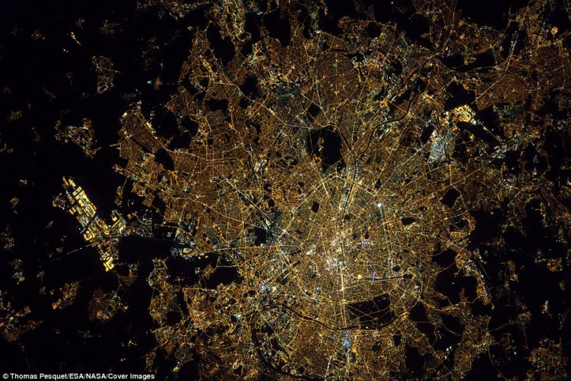 Par avion: Thomas Pesquet said this photo of Paris from the air was for all of his friends and colleagues at Air France. The images show the capital's two airports, Charles de Gaulle and Orly