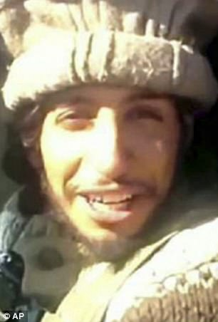 Smith photographed himself in front of a TV showing ISIS' Paris massacre mastermind Abdelhamid Abaaoud (pictured)