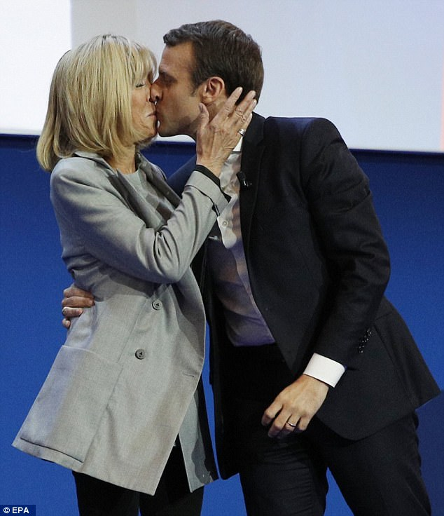 Onwards! Emmanuel Macron kisses his wife his wife Ms Trogneux-Macron after the first round of the French presidential elections in Paris on 23 April 2017