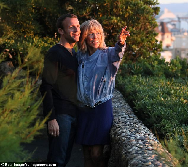 Love story: Former classmate Cecile Falcon told MailOnline that Emmanuel and Brigitte's relationship is 'a wonderful love story.' She added: 'Emmanuel was brilliant in class. Good at literature and philosophy, very intellectual but also charming. He never went for another student in a nasty way during a debate'. Pictured: The couple on holiday in Biarritz in August 2016