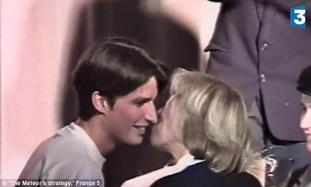 Smile of love: Emmanuel Macron beams as he receives a kiss from his drama teacher after a successful performance. 24 years later the two kissed on stage after Macron went through in the first round of presidential voting