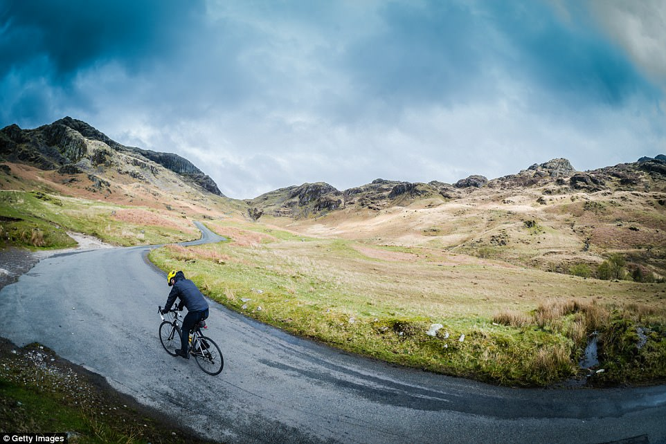 Gruelling road: The Hardknott Pass is the steepest road in England with inclines of 25-30 per cent - it is at the head of the Eskdale Valley in the Lake District National Park
