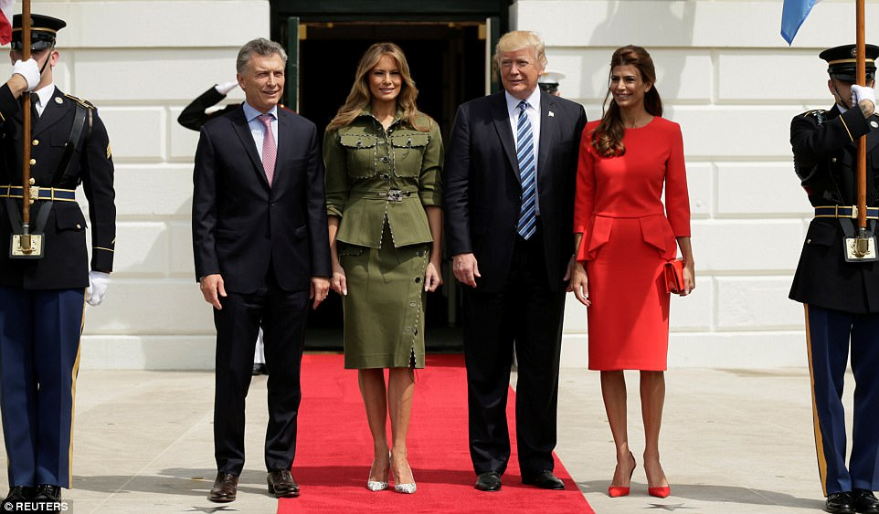 Melania posed in between Macri and Trump while they posed for photos in front of the South Lawn entrance
