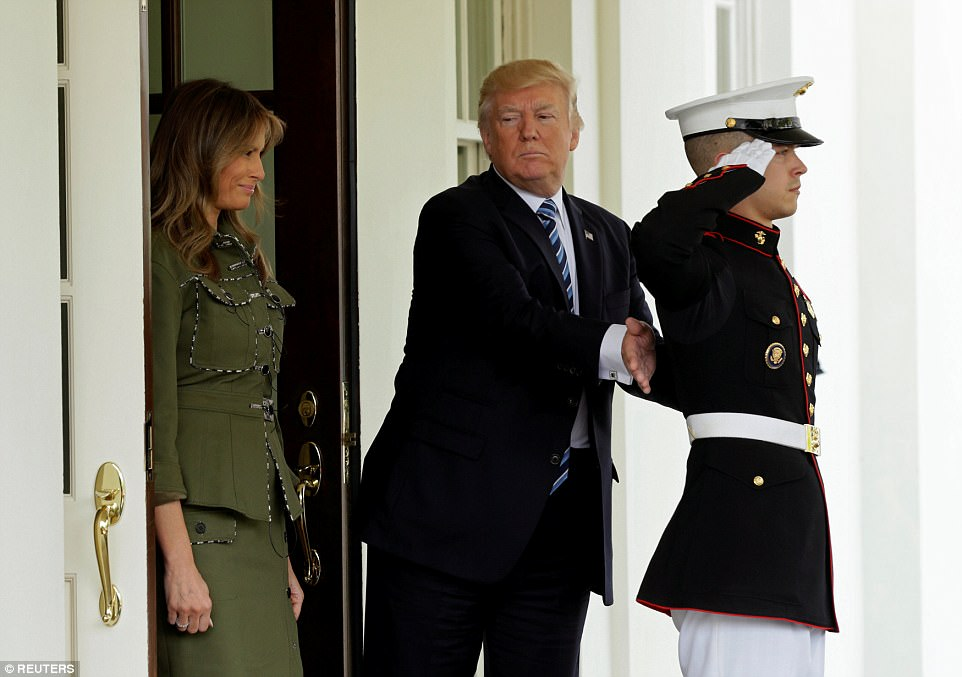 Donald Trump was seen patting a Marine on the back after saying goodbye to Argentine President Mauricio Macri and his wife,Juliana Awada. The Marine had tended the limousine doors for the Argentine couple's departure