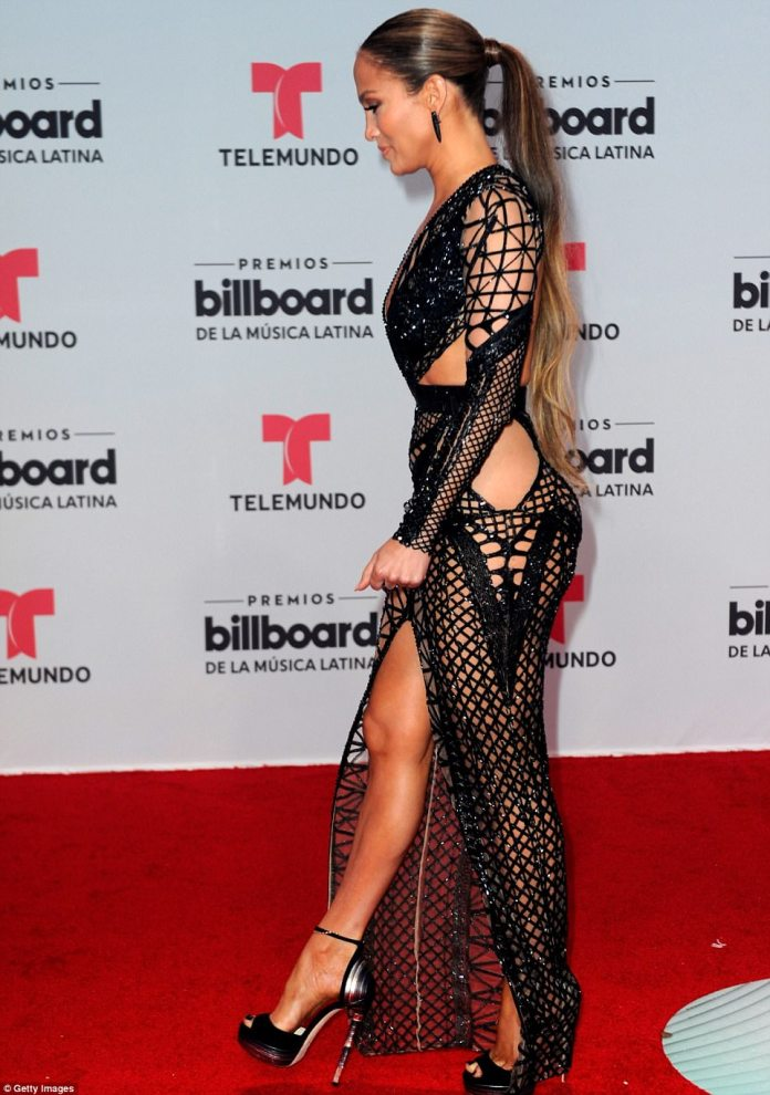 Famous curves: J-Lo had her famous curves on display in the dress