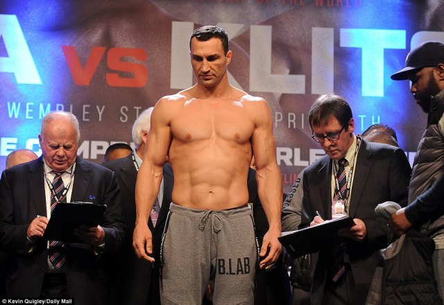 The 41-year-old Klitschko looks calm and composed as he steps on the scales and waits to discover his weight
