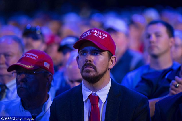 Among friends: NRA delegates were keen to show their support for the president at the convention, An estimated 10,000 were watching