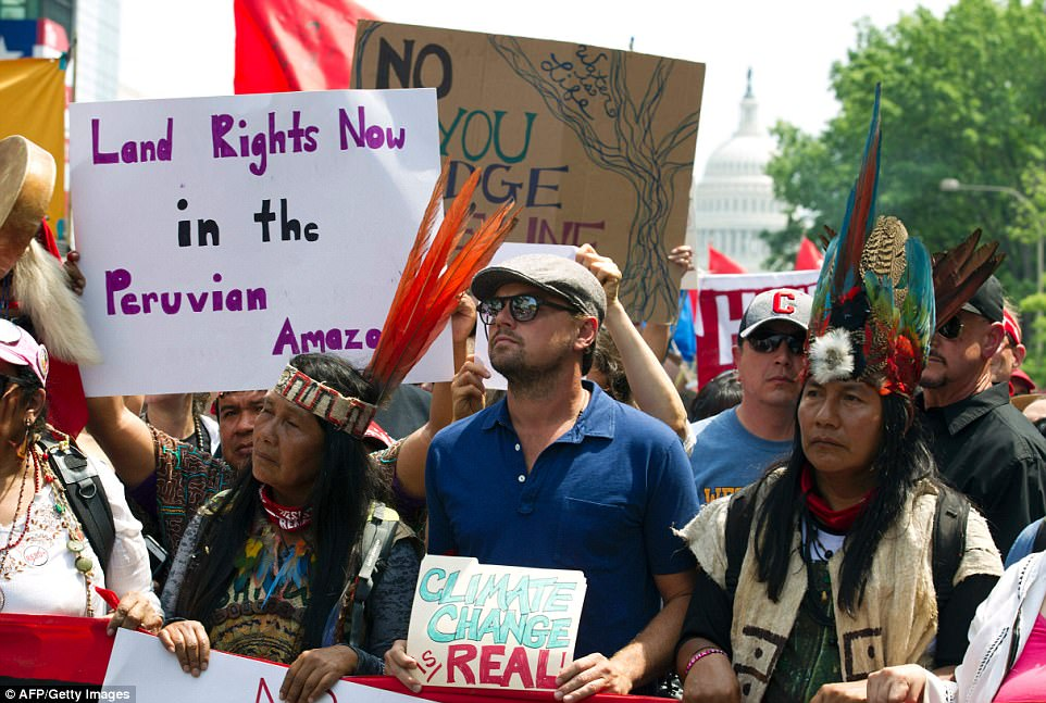 The actor, known for his environmental activism, held a sign that read 'Climate change is real' while marching alongside indigenous people from North and South America