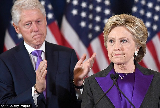 Hillary Clinton (right) is seen giving her concession speech in New York on November 9 as her husband, former President Bill Clinton (left), looks on - just hours after she lost the presidential election to New York real estate mogul Donald Trump