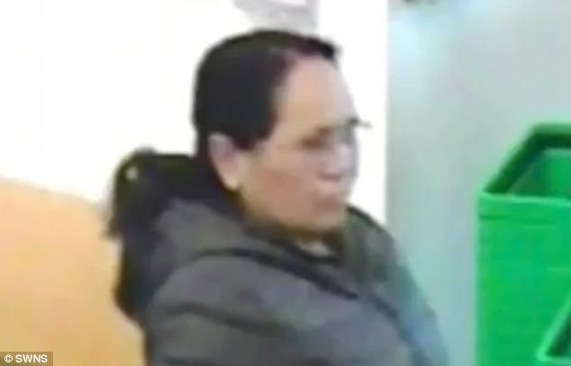 The suspect, pictured on CCTV, was described as Asian and aged around 65
