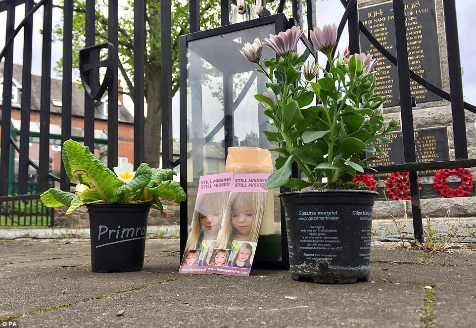 Outside the war memorial in the town, people also left items to remember Madeleine, who has now been missing since she was three years old