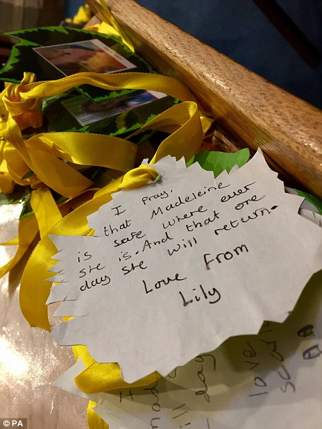 A tribute from a young girl named Lily is left at the church ahead of the arrival of the McCanns this evening