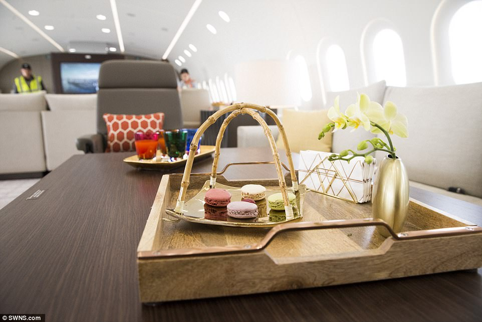 Finishing touches: Flowers, silk napkins and a tray of perfectly-positioned macaroons help ensure that every trip feels classy