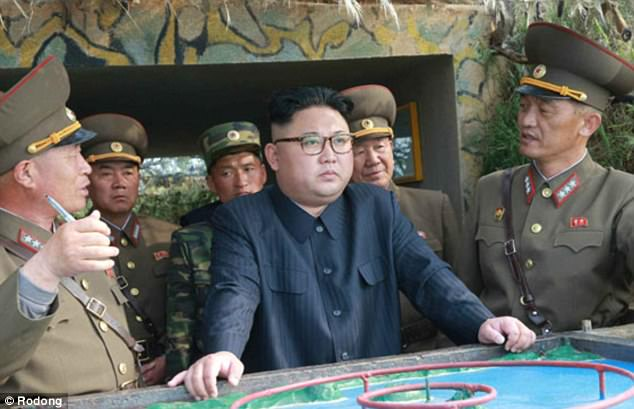 North Korean officials have accused the CIA of creating an assassination plot to kill the country's leader, Kim Jong-Un (pictured center)