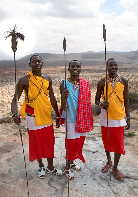 Spear-carrying tribesmen at the Saruni camp