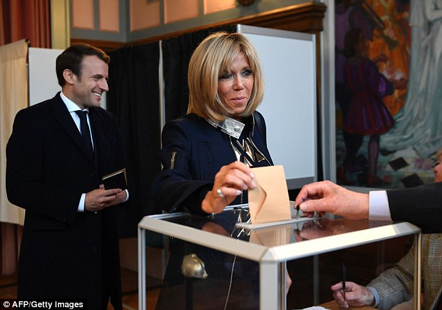 Pictured: The Macrons vote at the Le Touquet town hall, the place they had married 10 years before