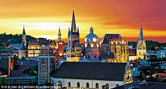 Shining example: The sunset casts a golden light over the historic German city of Aachen