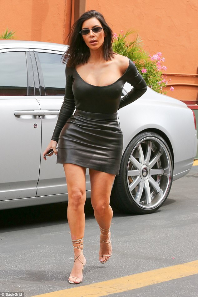 Sexy lady: Kim Kardashian showed off her chest and legs in this black outfit she wore to Chin Chin in LA on Monday