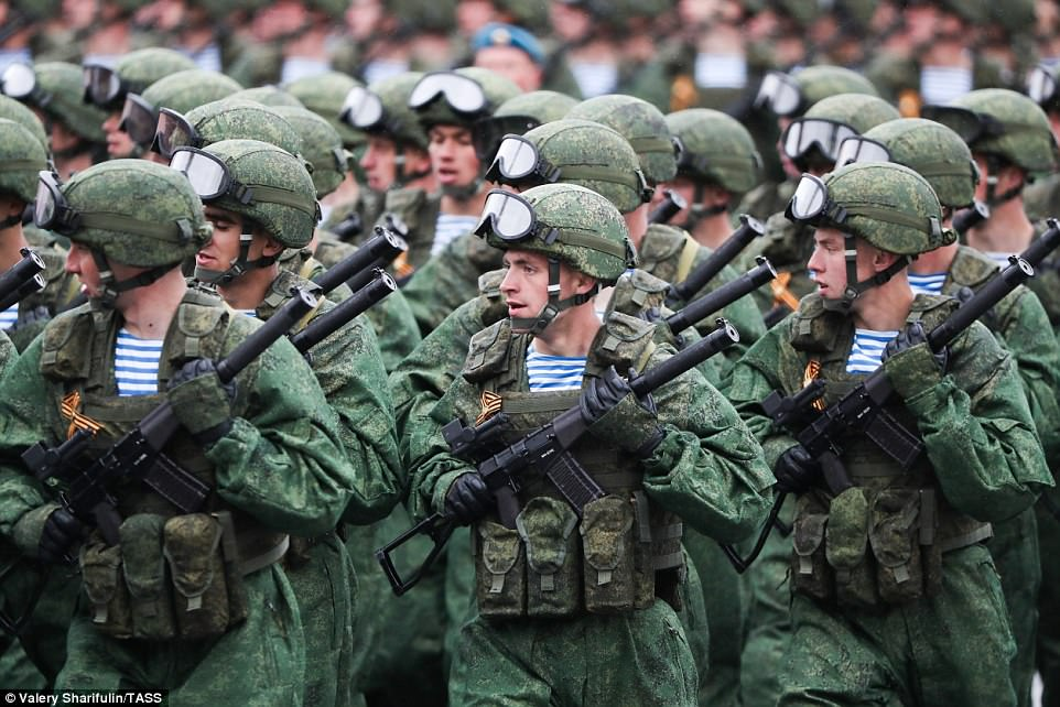 Thousands of armed military personnel marched in formation through Red Square on a day of celebrations in Moscow