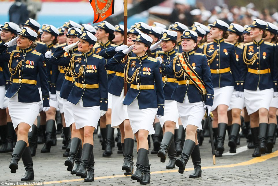 Female servicemen march in formation during the parade this morning. Putin used the event to show off his military might