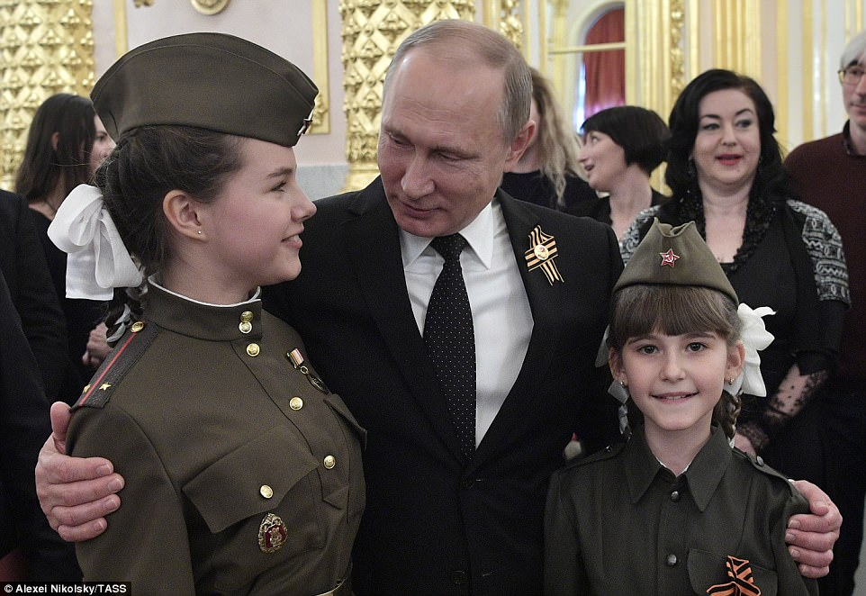 Russia's President Vladimir Putin (centre) greets guests at a Victory Day reception at the Moscow Kremlin this afternoon
