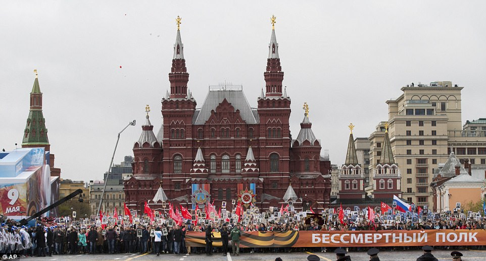 Russian and Soviet flags were waved while a banner was unfurled reading 'Immortal Regiment ', during the Victory Day event