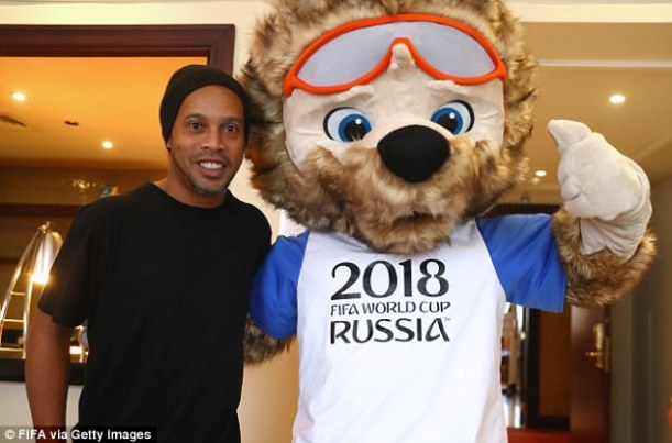 Ronaldinho, who won the World Cup in 2002, poses with Zabivaka ahead of the FIFA Congress