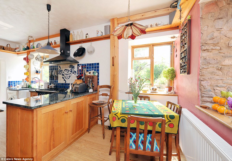 Rustic: The couples' kitchen and dining area are typical of the Devon countryside and add extra appeal to the listing