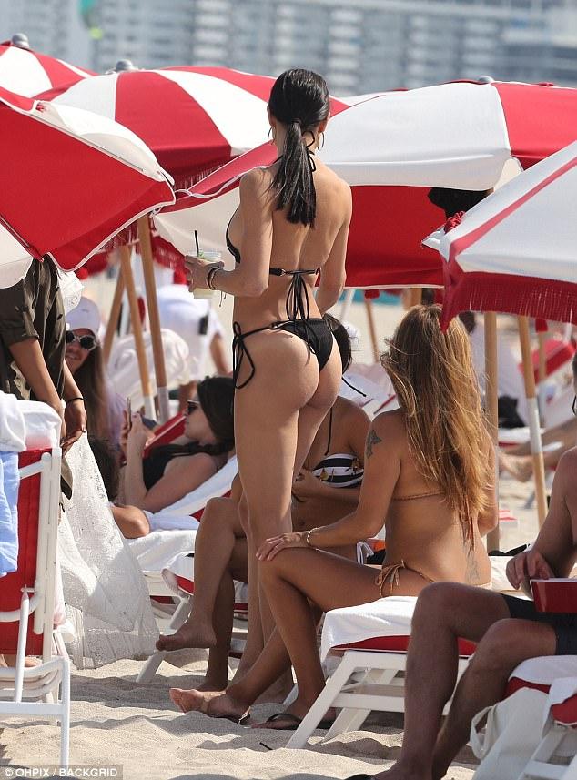 Beach side: The model showcased her long lean legs