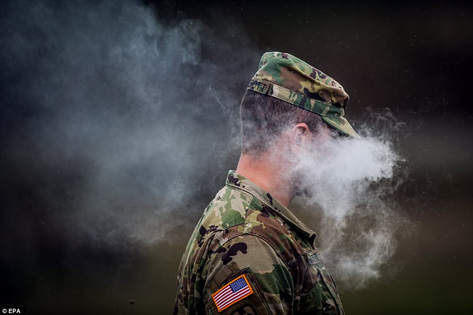 A US soldier smokes his e-cigarette as he takes a break during the friendly competition, designed to allow armies in NATO to learn from each other