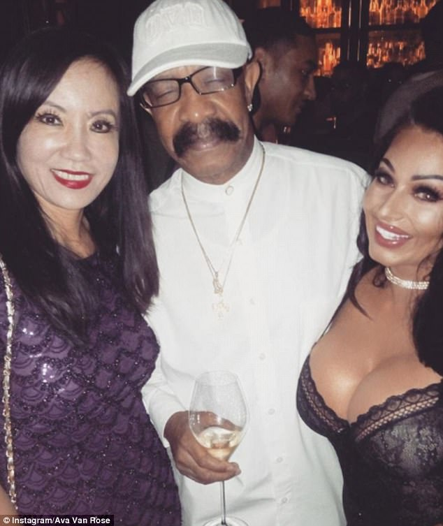 Rubbing shoulders: She shared a photo of herself mingling with Drake's father Dennis Graham to her <a  href=