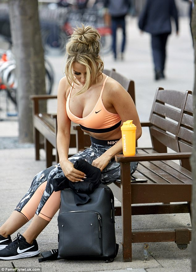 Taking a moment: Having worked up a sweat in the gym, Danielle was seen resting her legs out in London