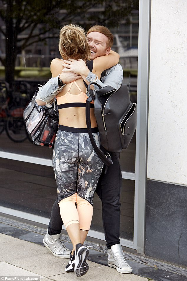 High spirits: Danielle scooped up her pal into an adoring hug