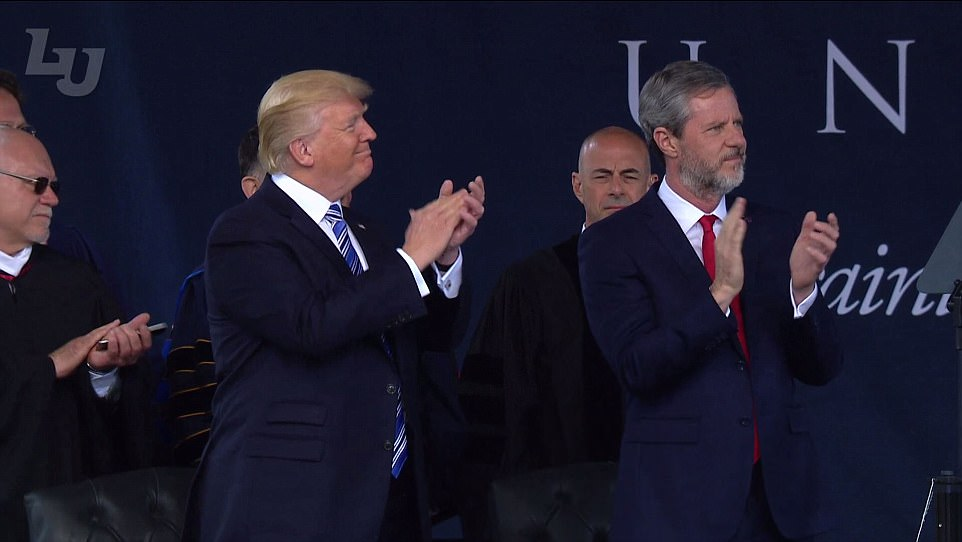 Trump was seated onstage next to Liberty University's president, Jerry Falwell Jr (right), who helped Trump win an overwhelming 80 per cent of the white evangelical vote in the 2016 presidential election