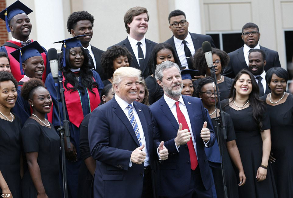 After he finished his address, Trump posed alongside Falwell in front of the choir. The pair gave two-thumbs up after the choir finished their song