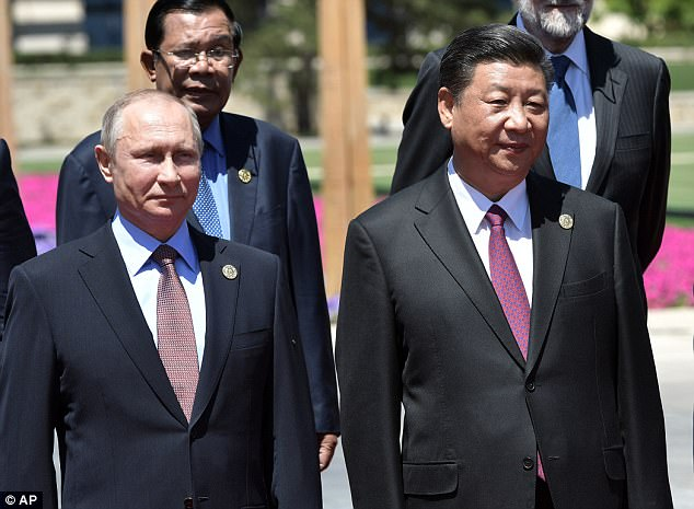 Putin said peaceful dialogue with the North, a position supported by China's Xi Jinping (pictured right), is the only way to resolve the situation