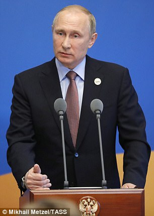 Putin speaks at an economic forum in China