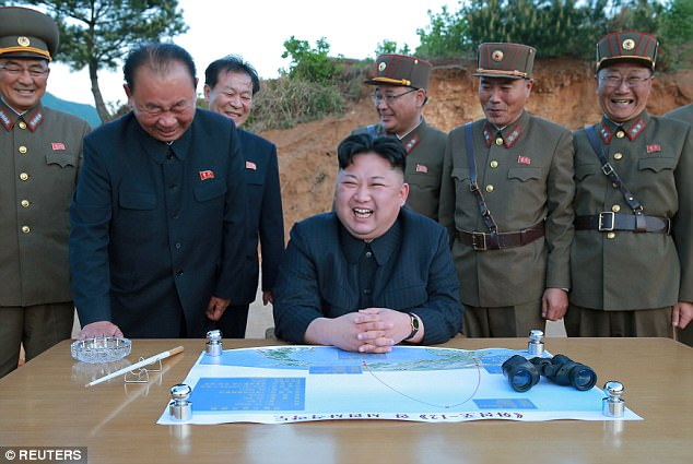 Kim Jong-un was pictured celebrating with his officials after the launch, and vowed to carry out more missile tests and nuclear detonations