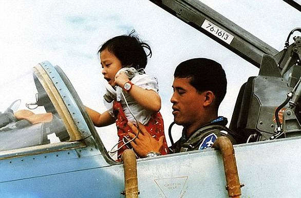 The King, a licensed pilot, in the cockpit of a fighter jet with one of his five children