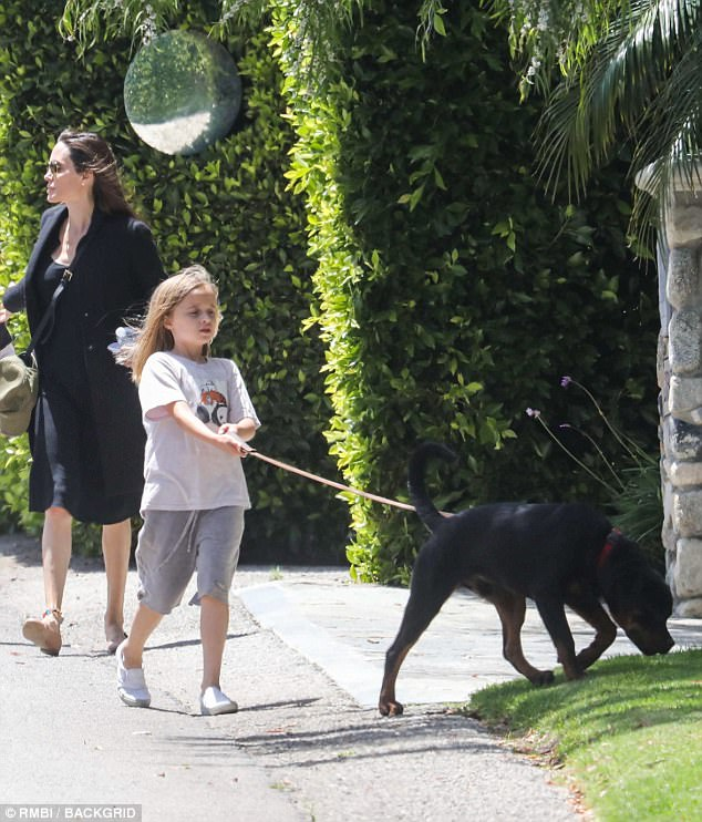 Leading the way: Vivienne held onto the dog's lead during the walk