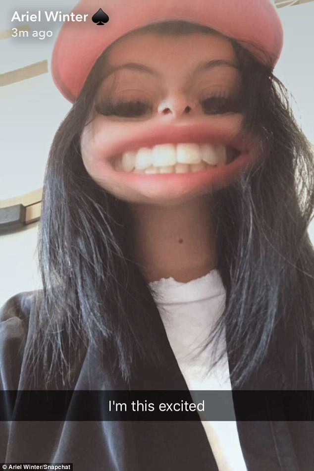 Smiling big:Another distorted selfie showed the star grinning at the camera with an exaggerated smile.'I'm this excited,' she captioned it