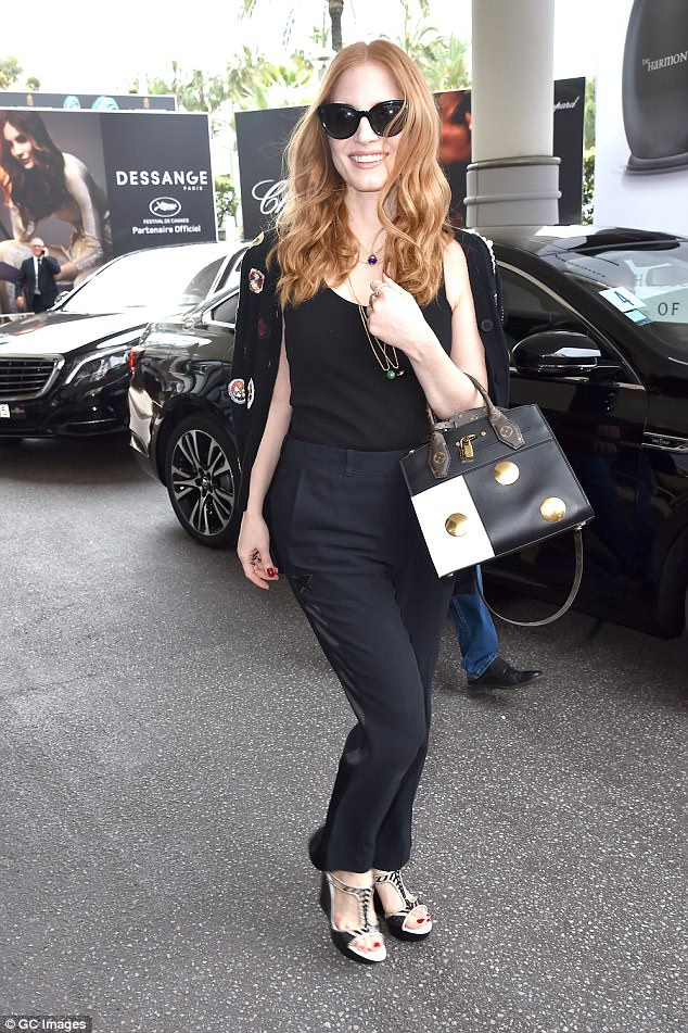 Jury service: Beaming Jessica Chastain wore all black ensemble and designer shades to leave her hotel ahead of judging duties at the Cannes Film Festival on Thursday