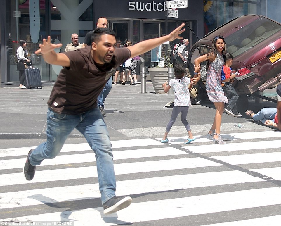 The driver, Richard Rojas, 26, eventually crashed his maroon Honda sedan into a pole and tried to flee the scene (above) as others watch on in terror. The photographer who took the image later revealed he did not know Rojas was the motorist responsible for the carnage. He believed the perpetrator was still in the car