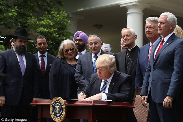 Trump signed an executive order to allow tax-exempt churches to participate in politics earlier this month. He said 'We are a nation of believers' and affirmed the history of religion in the US