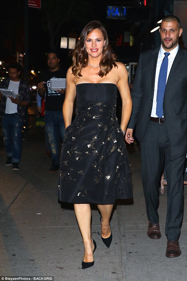 Beaming: The mother-of-three looked amazing as she made her way into theLandmark Sunshine Theater