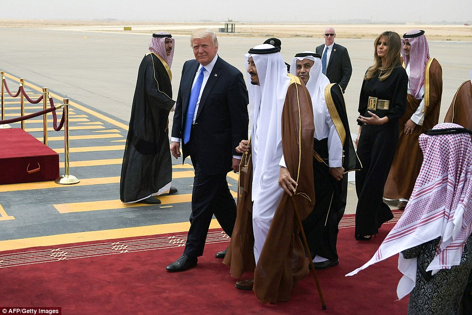 Donald Trump is pictured with his wife Melania meeting King Salman of Saudi Arabia
