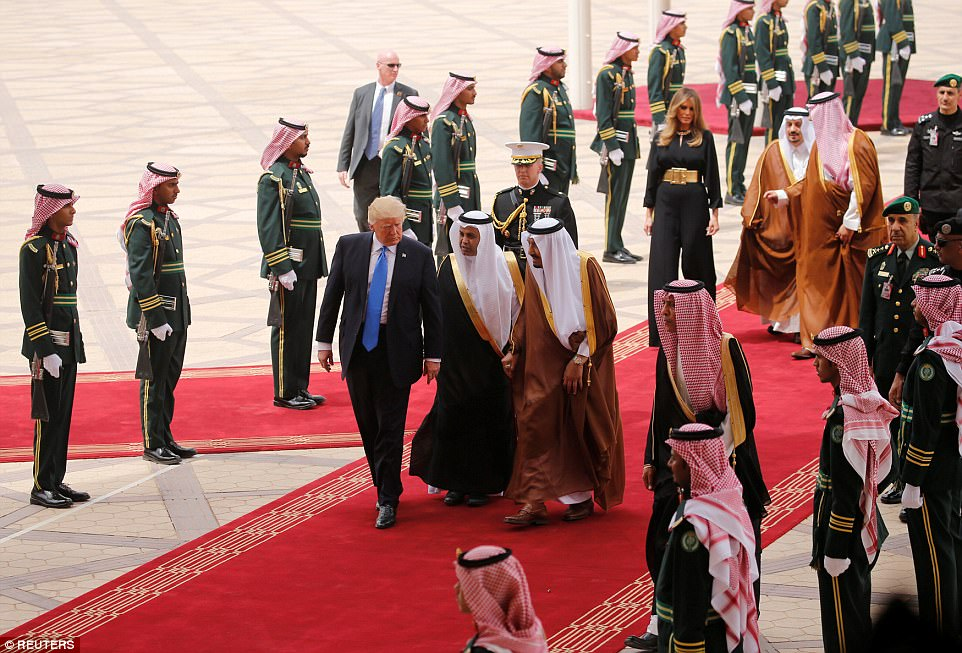 Saudi Arabia's King Salman bin Abdulaziz Al Saud welcomes US President Donald Trump during a reception ceremony this morning
