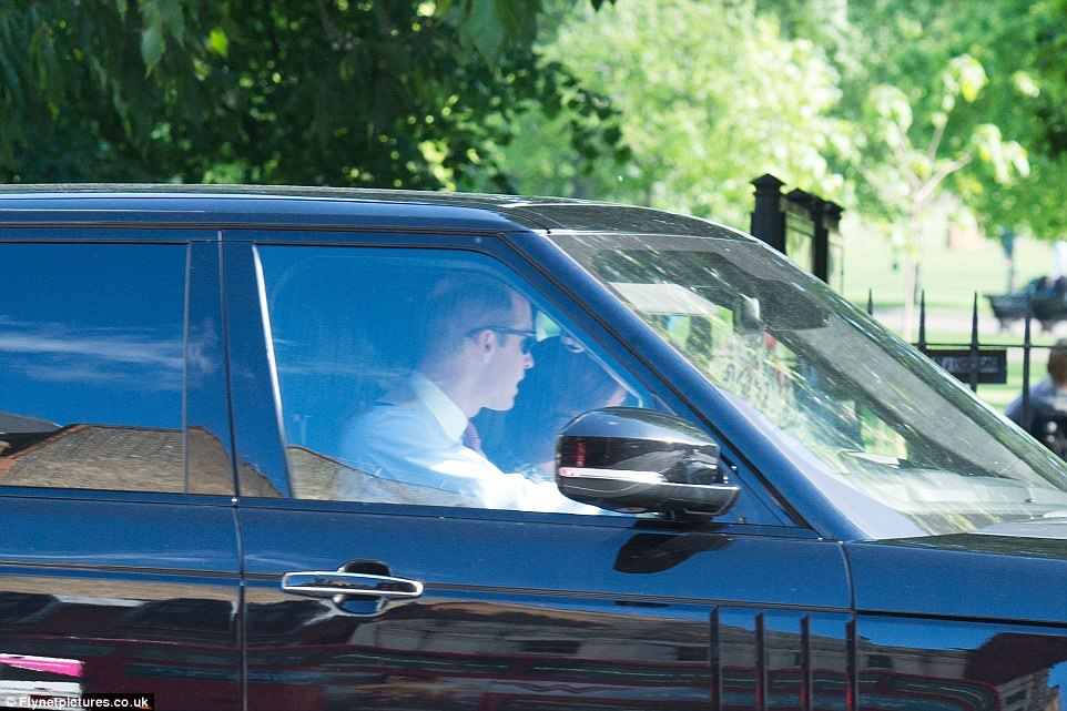 Prince William, who looked dapper in a satin waistcoat and red tie, drove his family-of-four in their Range Rover to the society wedding of the decade