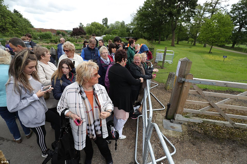 Excited fans waited behind the metal barriers hoping to catch a glimpse of the bride at St Mark's Church on Friday
